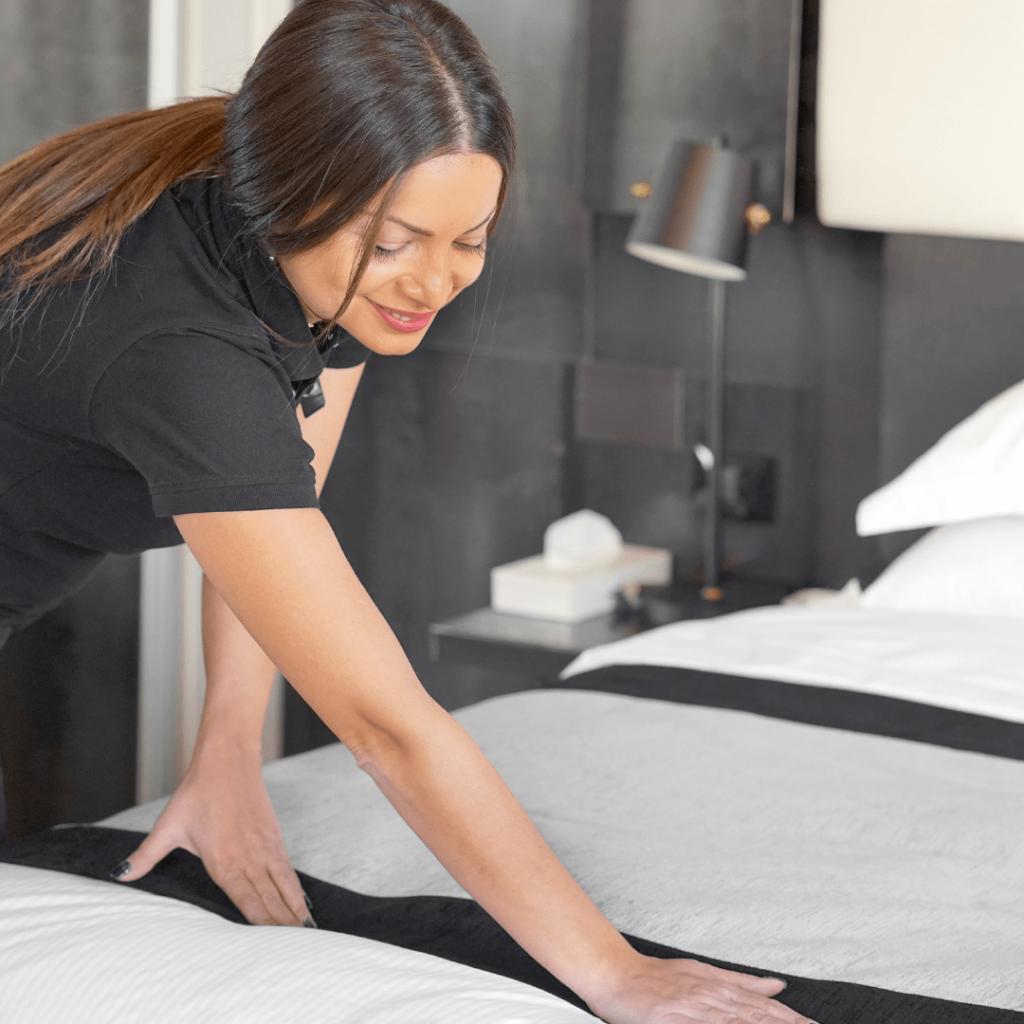 house cleaner making bed