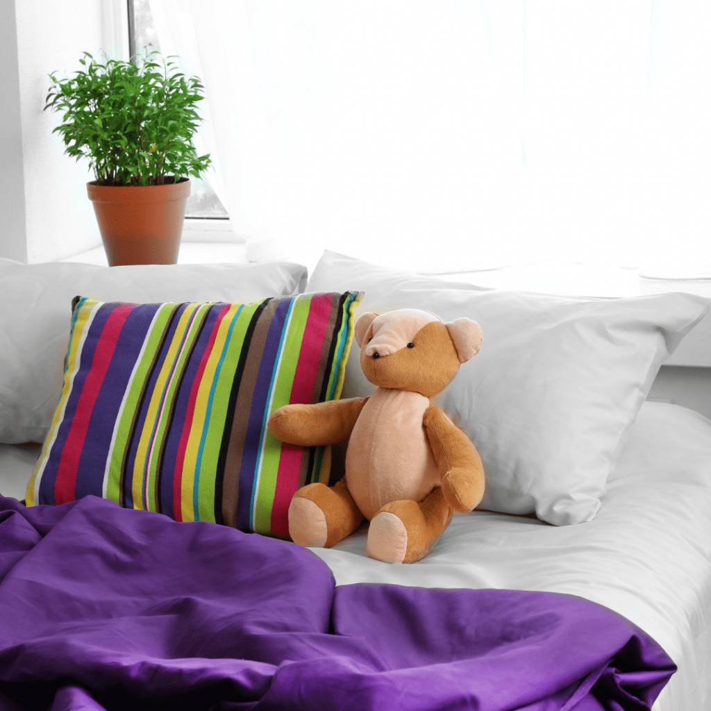 cleaner arranging pillows or toys